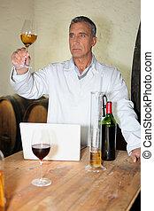 Winemaker analyzing wine