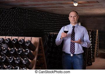 Winemaker proposing degustation of red wine - Professional ...