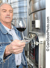 Winemaker with a glass of wine