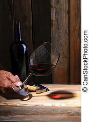 Winemaker's hand with glass - A winemaker holding a glass of...