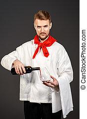winemaking industry - Male sommelier tasting red wine....