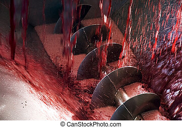 An auger used in the production of wine and red grape juice.