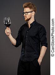 winemaking - Male sommelier tasting red wine. Winemaking....