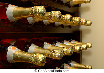 Rows of bottled wine in a winery. Focus = 2nd bottles from the left. 12MP camera.