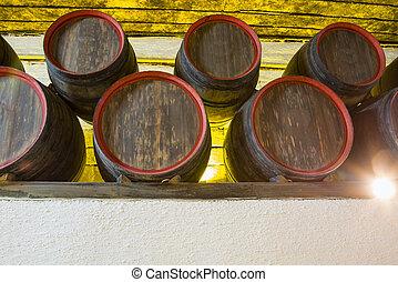 Winery cellar storage area - Underground wine barrels stack,...