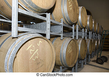 Winery - Wine wooden barrels in a winery