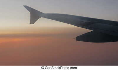 wing of a passenger plane flying high in the sky