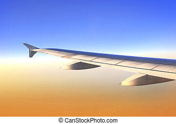 Wing of aircraft in sunrise light - Wing of aircraft in...