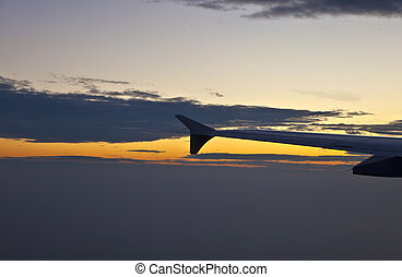 wing of aircraft in the sky
