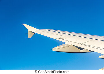 Wing of airplane from window