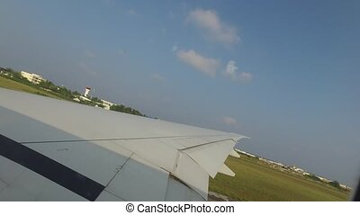 wing of airplane gathering speed on runway - travel,...