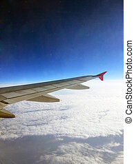 Wing of airplane through window