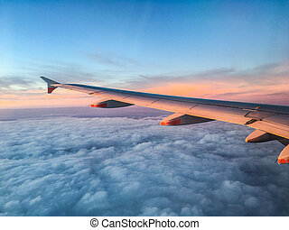 Wing of an Airplane at Sunset