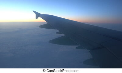 Wing of an airplane in the sunrise