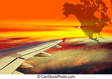 Wing of the plane at sunset - Wing airplane on North America...