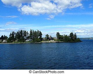 Wing Point on Bainbridge Island, Washington State seen from the water.