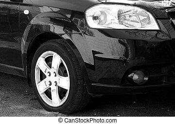 Wing, wheel and car headlight black, close-up