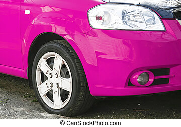 Wing, wheel and car headlight bright color, close-up