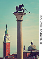 Winge lion on marble column in Venice, Italy.