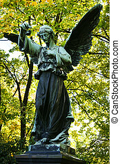 winged angel holding a flower