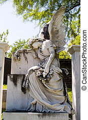 Winged angel with a sorrowful pose