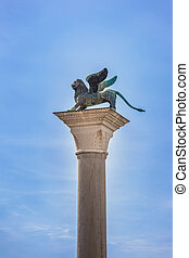 Winged St Mark Lion Venice symbol on its column. Italy.