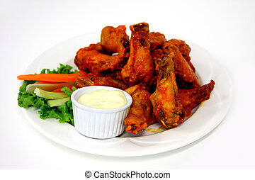 wings - plated wings with celery and carrots