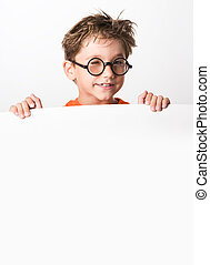 Winking - Cute lad winking through glasses while standing...