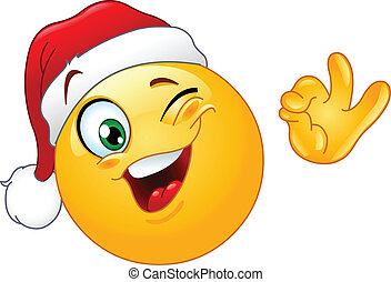 Winking emoticon with Santa hat - Winking emoticon wearing...