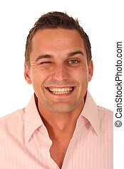Winking Handsome Man - Cheerful young man in pink shirt ...
