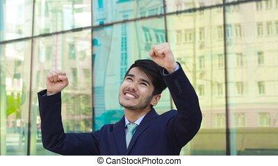 Winner dance from asian businessman - Businessman dancing...