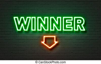 Winner neon sign on brick wall background.