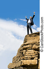 Winner - View of successful businessman raising his hands