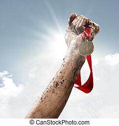 winner - hand holding a winner's medal, success in...