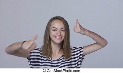 Winner, success concept. Happy teen girl celebrating success...
