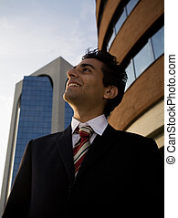 winner - successful businessman staring at the sky and...