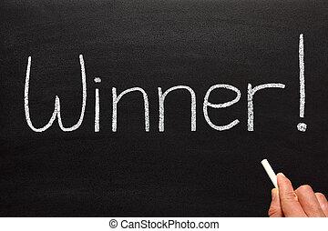 Winner, written on a blackboard.