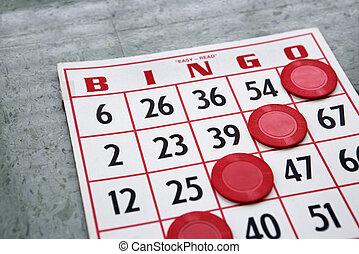Winning game card. - Red bingo card with winning chips.