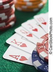 Winning hand of cards on casino table - Winning hand of...
