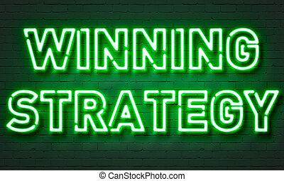 Winning strategy neon sign on brick wall background.