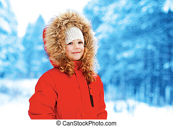 Winter and people concept - happy child in winter forest