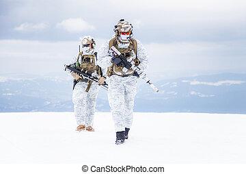 Winter arctic mountains warfare - Army servicemen in winter...