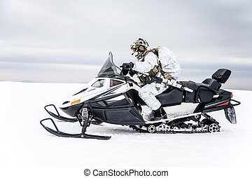 Winter arctic mountains warfare - Army soldier in winter...