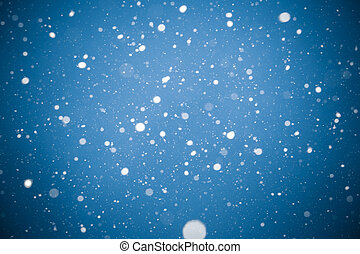 Winter background. falling snow on blue background