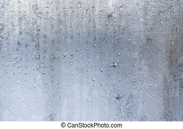 Winter background from lot of  frozen  water drops on window.