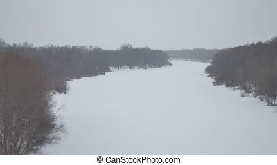 winter background. frozen aerial view river with reeds and...