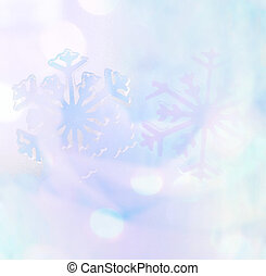 Winter background. Snowflakes on blue soft tone.