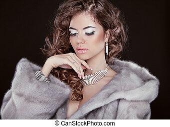 Winter beautiful girl wearing in mink fur coat with long...