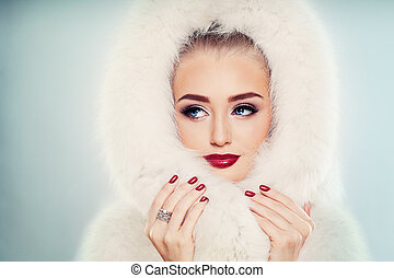Winter Beauty. Fashion Portrait of Cute Winter Woman with Makeup. Face Closeup