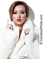 Winter beauty - Young brunette lady in white fur coat posing...